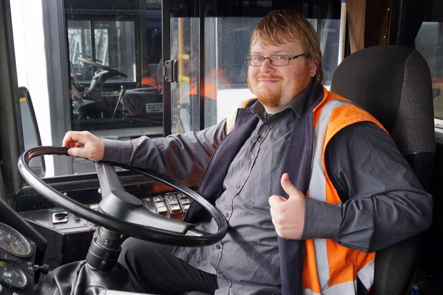 Picture of a client seated in the drivers seat of a bus